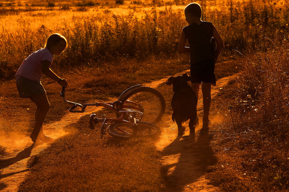 Children must certainly be happy, because childhood is the most wonderful time. Childhood when the yellow color is bright yellow, the trees are living giants, and you can touch the moon with your hand Adult Adults Only Childhood Family Friendship Full Length Kids Leisure Activity Nature Nature_collection Outdoors Rural Scene Russia Summer Sunset Togetherness Two People Lifestyles Light Summer of 2015. Time before sunset