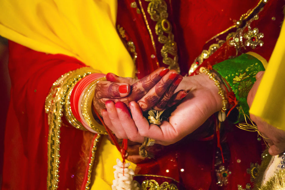 Indian Wedding ceremony -Bride and Bridegroom holding hands Bangle Bride Bridegroom Celebration Close-up Cultures First Touch Hand In Hand Human Body Part Indian Wedding Indian Wedding♥ Red Religion Rituals & Cultural Sari Traditional Clothing Wedding Wedding Wedding Ceremony Wedding Culture Wedding Photography