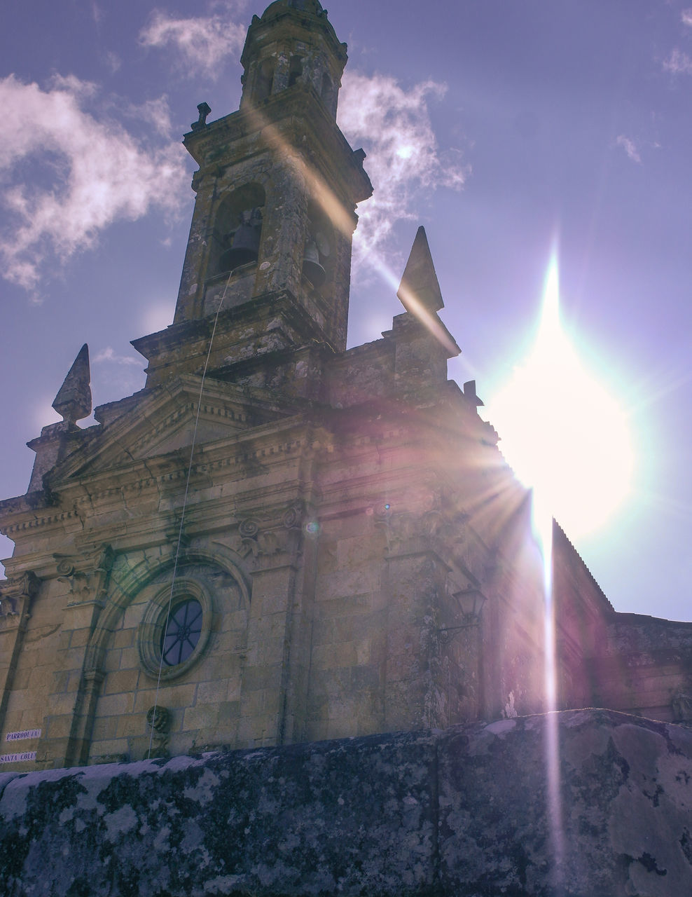 religion, spirituality, lens flare, place of worship, architecture, low angle view, sunbeam, sunlight, built structure, sky, no people, history, building exterior, day, outdoors, bell tower, nature