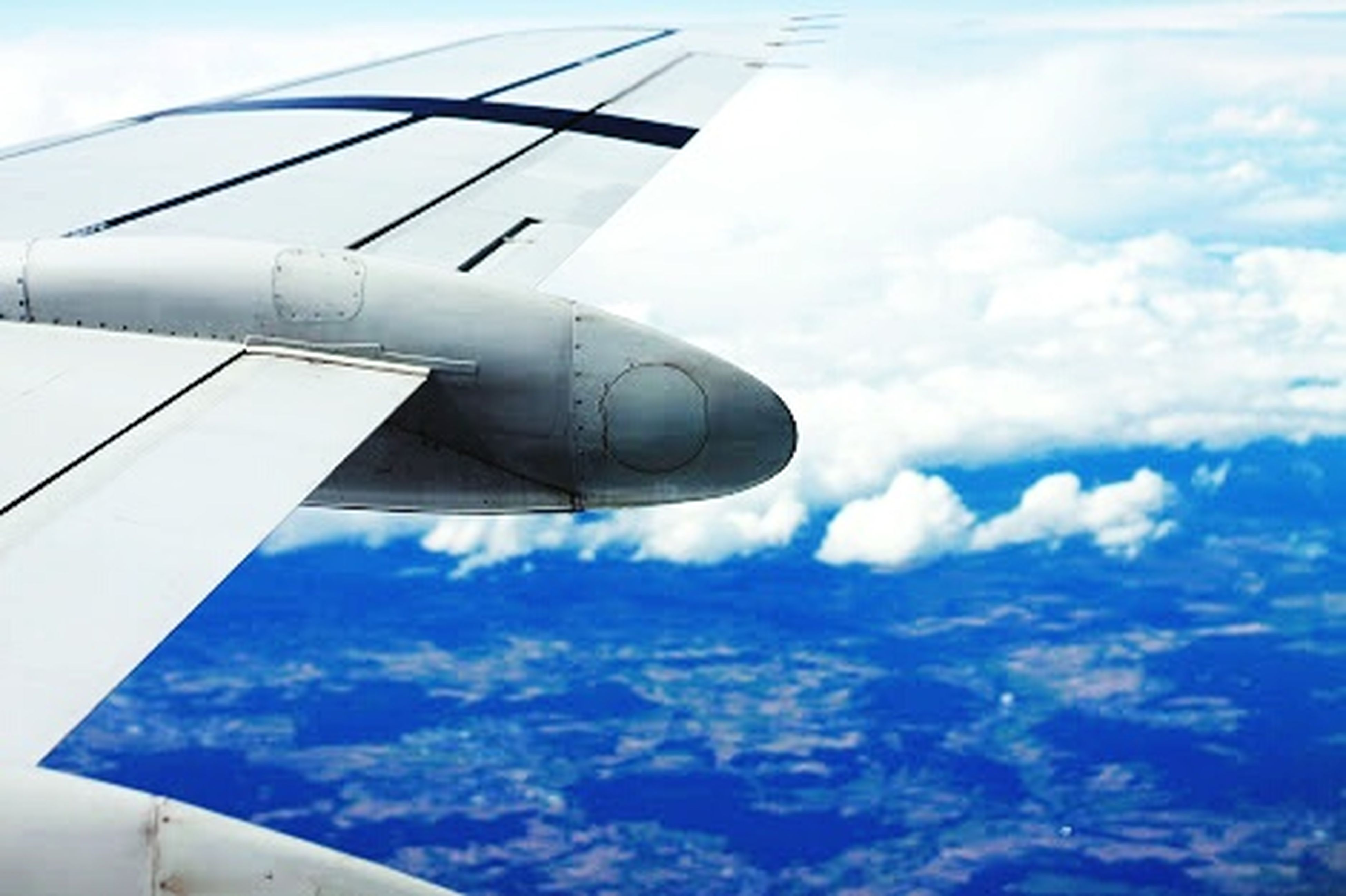 airplane, air vehicle, flying, transportation, mode of transport, aircraft wing, sky, mid-air, part of, cloud - sky, cropped, journey, travel, public transportation, aircraft, cloud, on the move, aeroplane, commercial airplane, aerial view