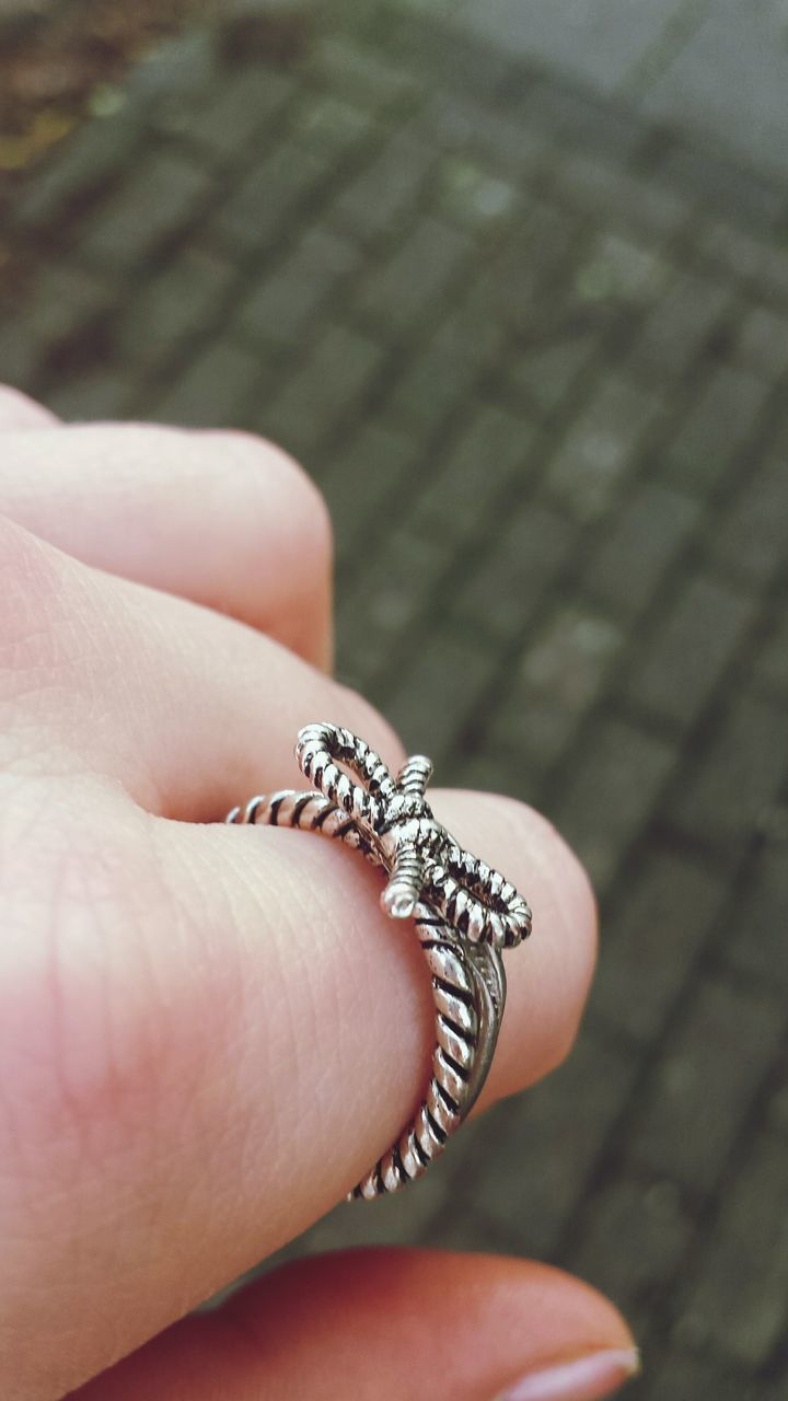 human hand, human body part, jewelry, human finger, one person, real people, close-up, fashion, holding, outdoors, day, men, adult, people