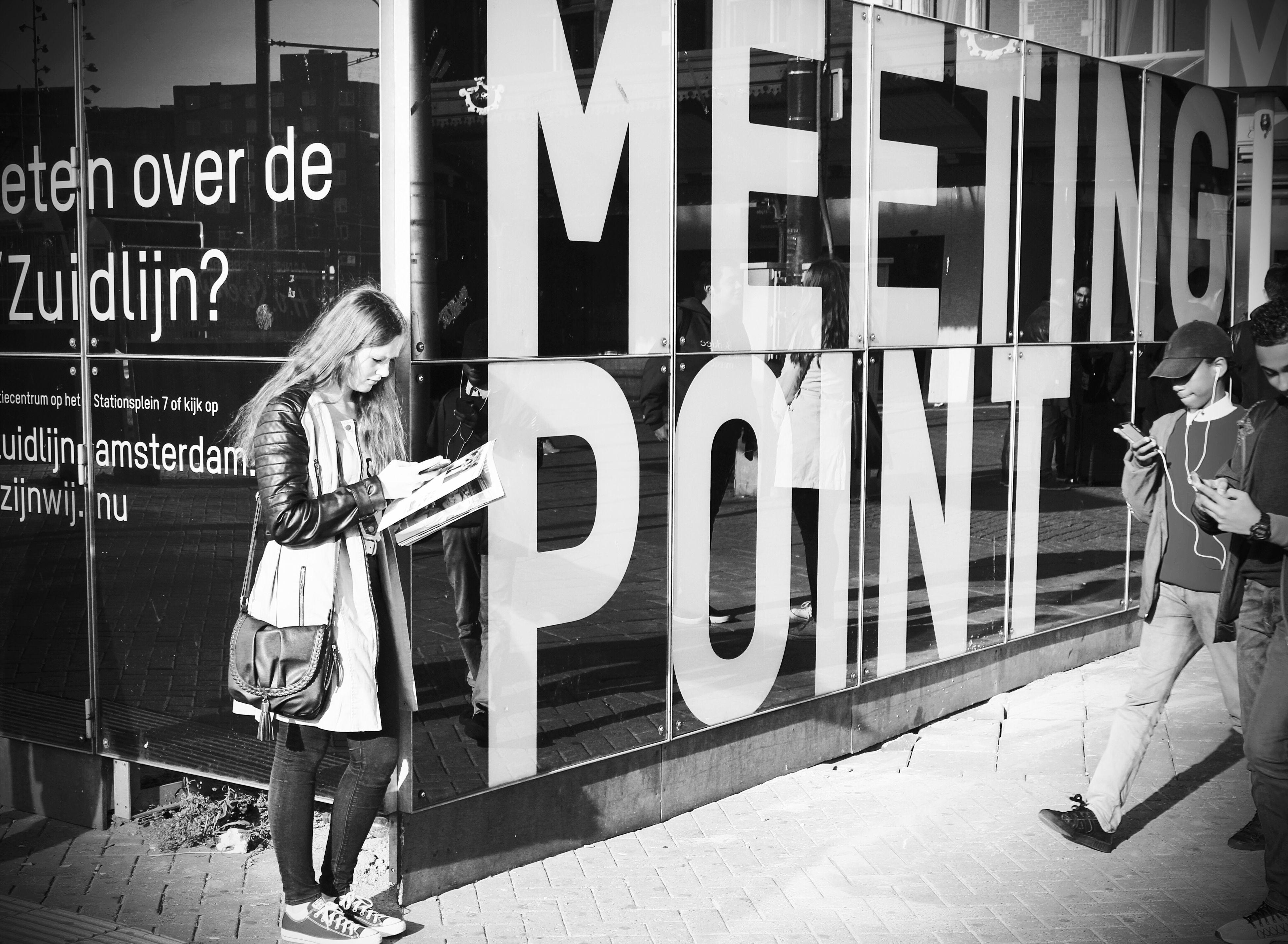 text, blackboard, city, alphabet, men, people, adult, outdoors, day