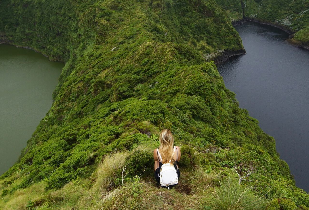 EyeEmNewHere Nature Green color beauty in Nature Tranquility real people tranquil scene outdoors Sitting leisure activity day Tree scenics lifestyles women Grass water Growth blond hair young women travel destinations Travel Photography