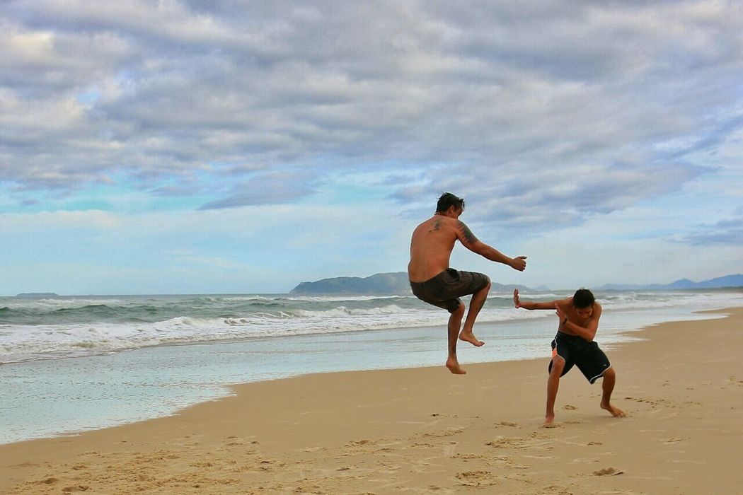 People And Places Nature Sea Sky Clear Sky People Of The Oceans Fight Fighting Capoeira Ocean View Martial Arts Game Beachphotography Beach Time Jumping