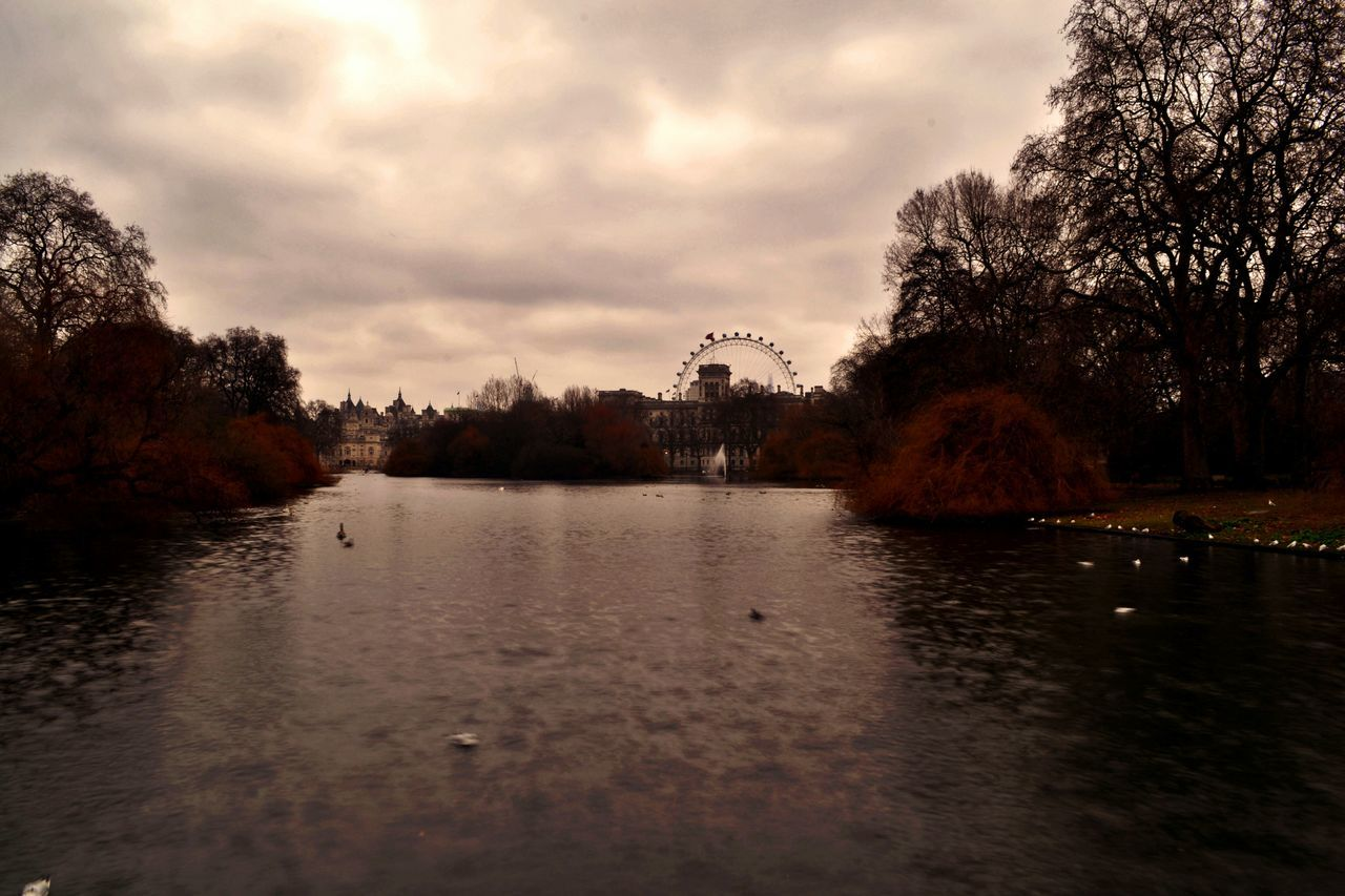 Pond In Park In City, Ferris Wheel In Background