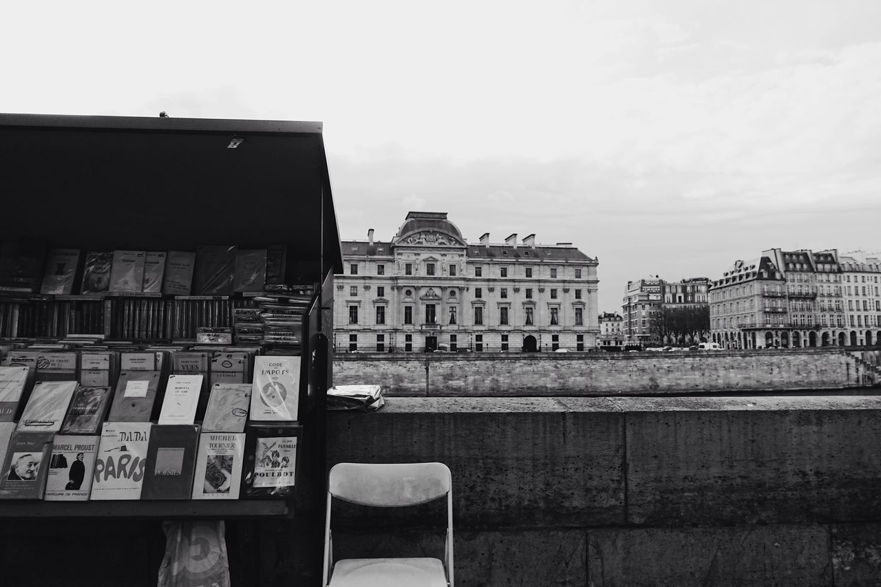 an Afternoon//. Paris Seine Riverside Books Outdoors City City Life Cityscape Streetphotography Waiting Built Structure Building Exterior Architecture Blackandwhite Black And White Lifestyles Life Building France Style Europe Travel View Urban Lifestyle