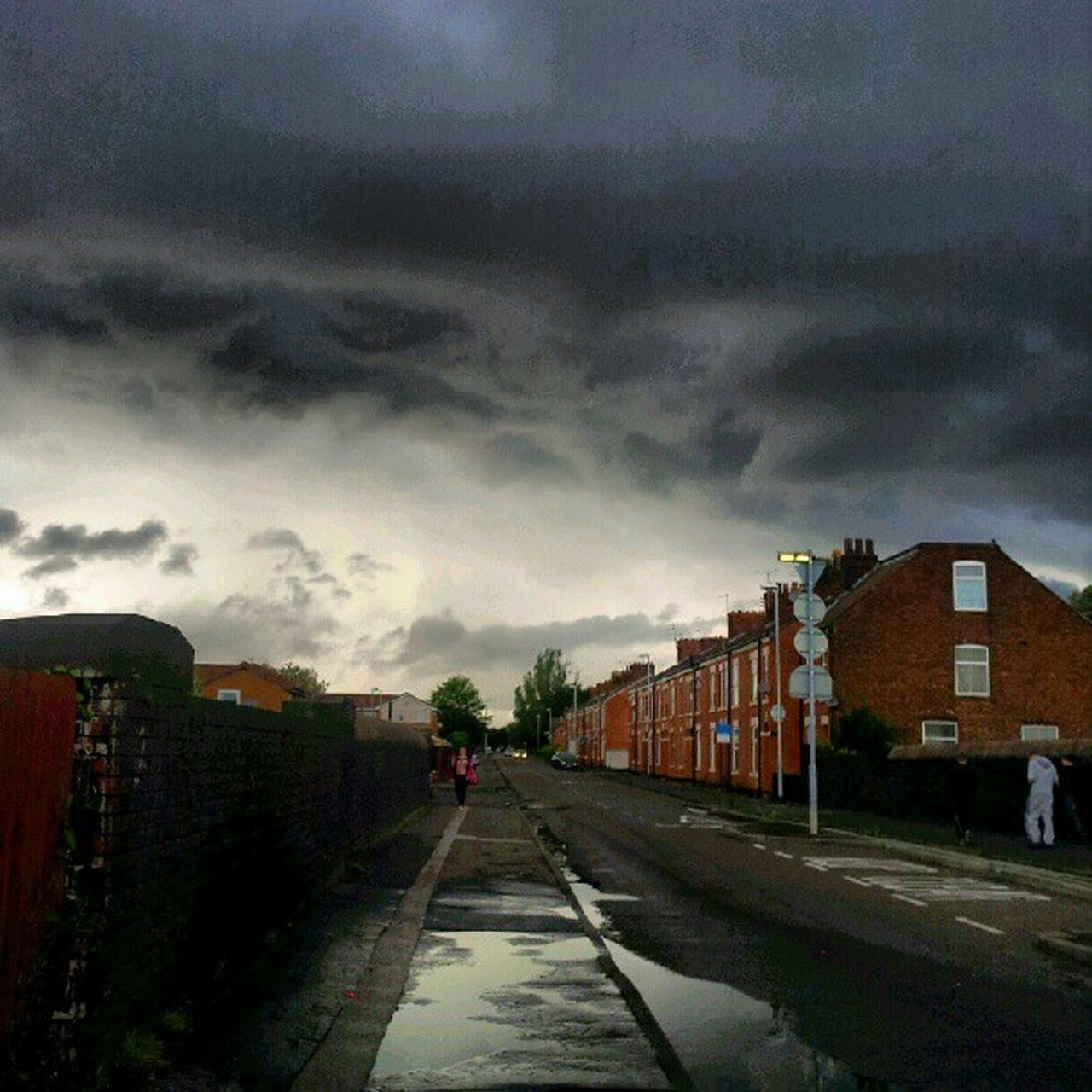 cloud - sky, sky, weather, architecture, storm cloud, built structure, building exterior, city, house, car, the way forward, outdoors, no people, transportation, road, day, nature