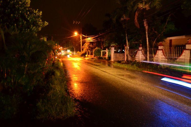 A rural road on a rainy night (M, f/2.8, 0.77sec., ISO1600, 11mm). Night Illuminated Road Transportation Street Rural The Way Forward Car No People Outdoors Sky Nature Rainy Province Life Tokina 11-16 F/2.8 Tokinalens Nikon D3100 Nikonphotography Eyeem Philippines EyeEmNewHere Philippines