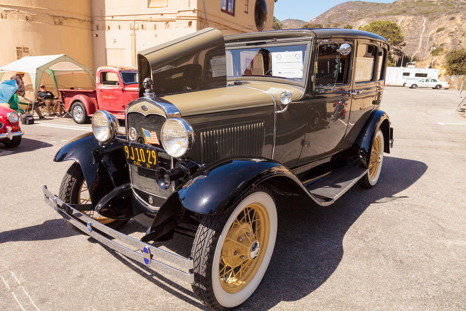 Laguna Beach, CA, USA - October 2, 2016: Tan 1931 Ford Slant Window Town Sedan owned by David and Susie Russell and displayed at the Rotary Club of Laguna Beach 2016 Classic Car Show. Editorial use. 1931 Car Show Classic Car Classic Car Show Ford Laguna Beach Old Car Sedan Slant Window Town Sedan Vintage Car