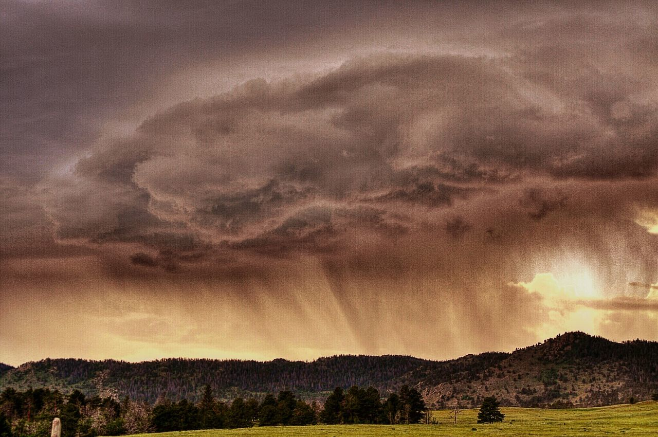 sky, cloud - sky, sunset, nature, dramatic sky, beauty in nature, scenics, tranquil scene, tranquility, landscape, outdoors, silhouette, storm cloud, no people, tree, mountain, power in nature, day, lightning