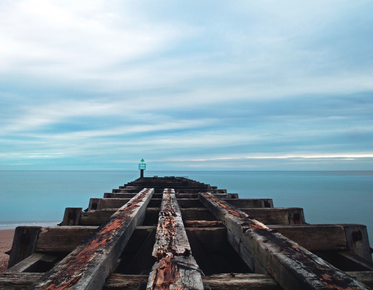 sea, water, horizon over water, cloud - sky, sky, scenics, nature, pier, tranquility, tranquil scene, day, no people, beauty in nature, outdoors, jetty, blue, groyne, fishing pole