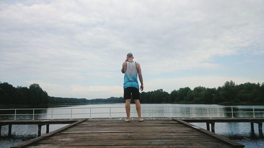 Man on the edge. OnTheEdge Manontheedge Atthelake Woodenbridge Lake
