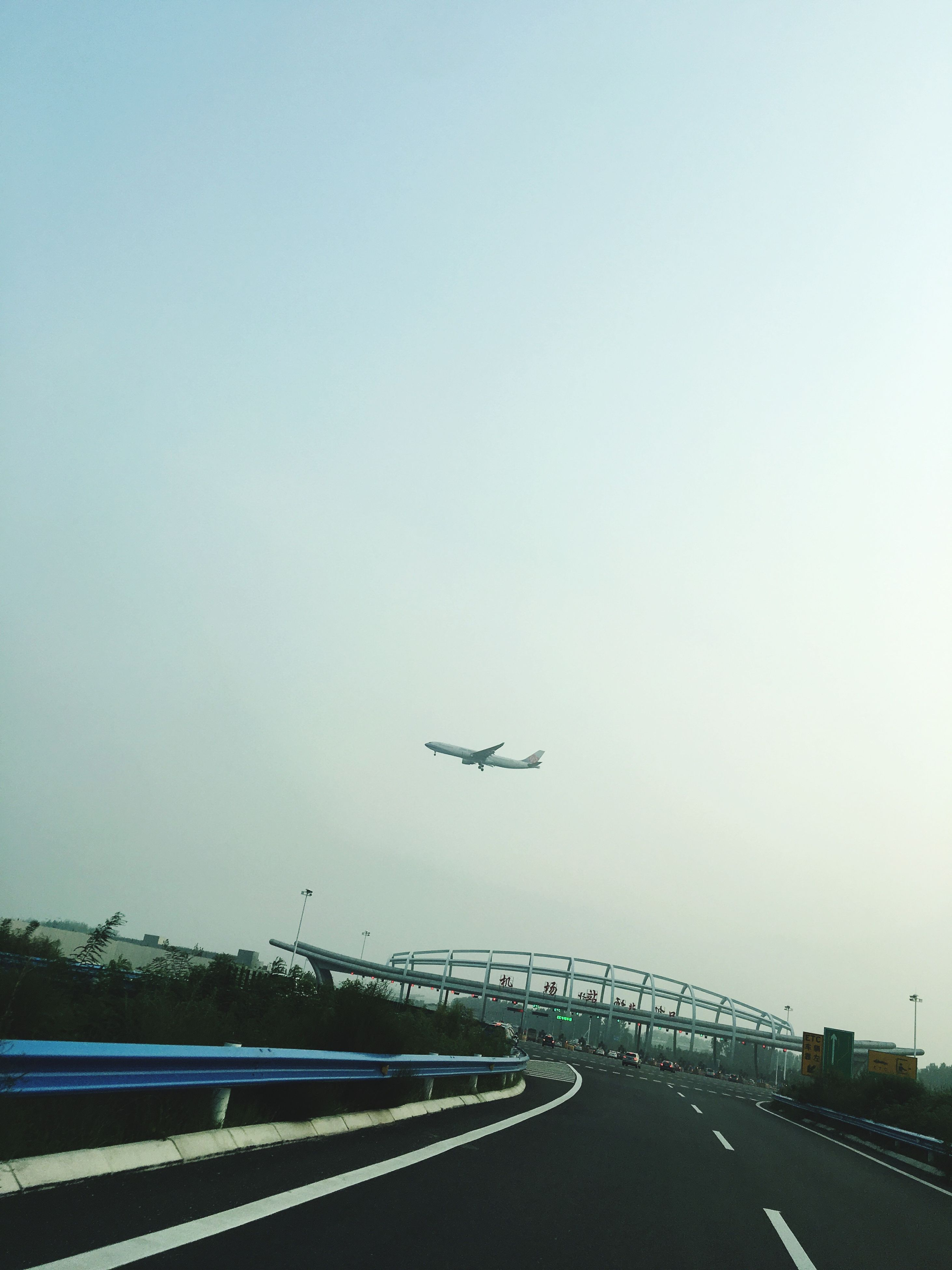 transportation, mode of transport, clear sky, road, airplane, air vehicle, copy space, on the move, the way forward, road marking, flying, journey, dividing line, mid-air, day, airport runway, outdoors, long, vanishing point, country road, no people