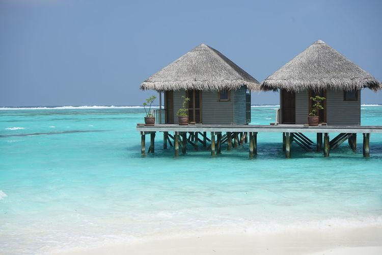 Meeru Island Resort & Spa, Maldives Blue Sea Maldives Meeru Island Beach Beauty In Nature Blue Clear Sky Day Luxury Meeru Nature No People Outdoors Paradise Scenics Sea Sky Thatched Roof Water White Sand