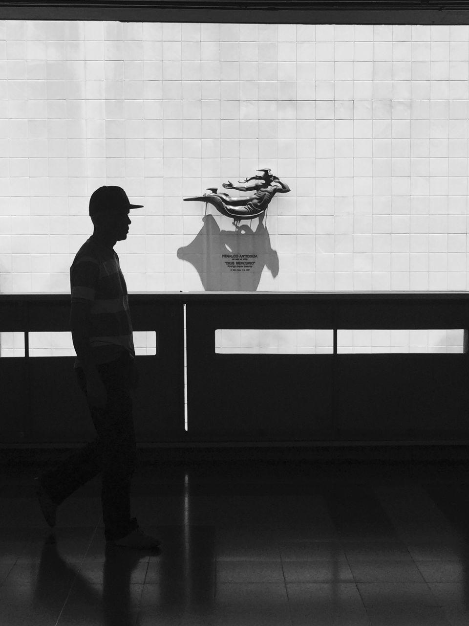 Silhouette Man Walking In Subway
