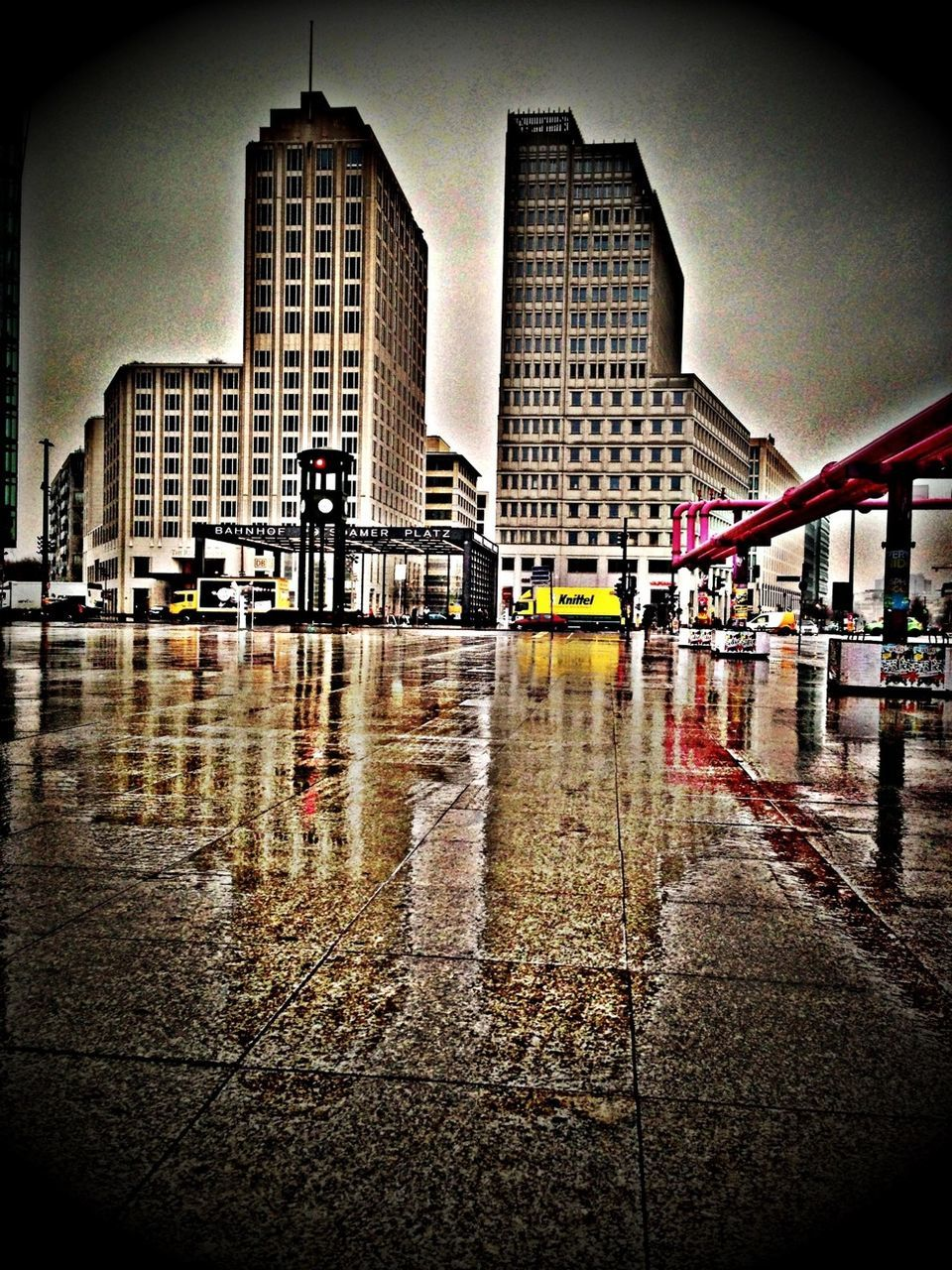 architecture, built structure, water, reflection, wet, day, building exterior, outdoors, city, no people, skyscraper, puddle, sky, modern
