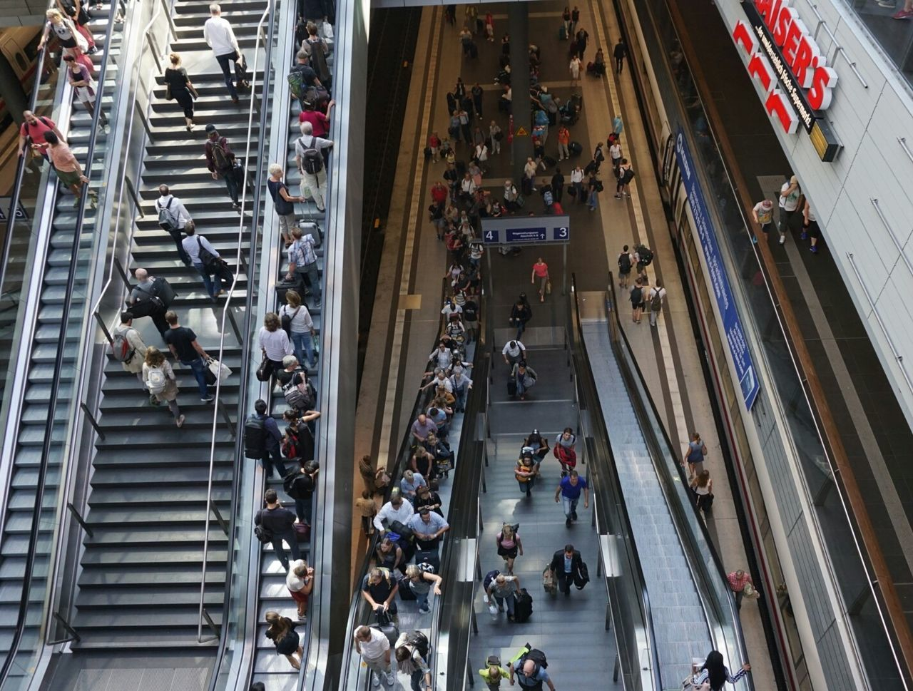large group of people, high angle view, architecture, crowd, retail, built structure, modern, lifestyles, walking, consumerism, real people, men, people, day, women, city, rush hour, building exterior, outdoors, adult, adults only