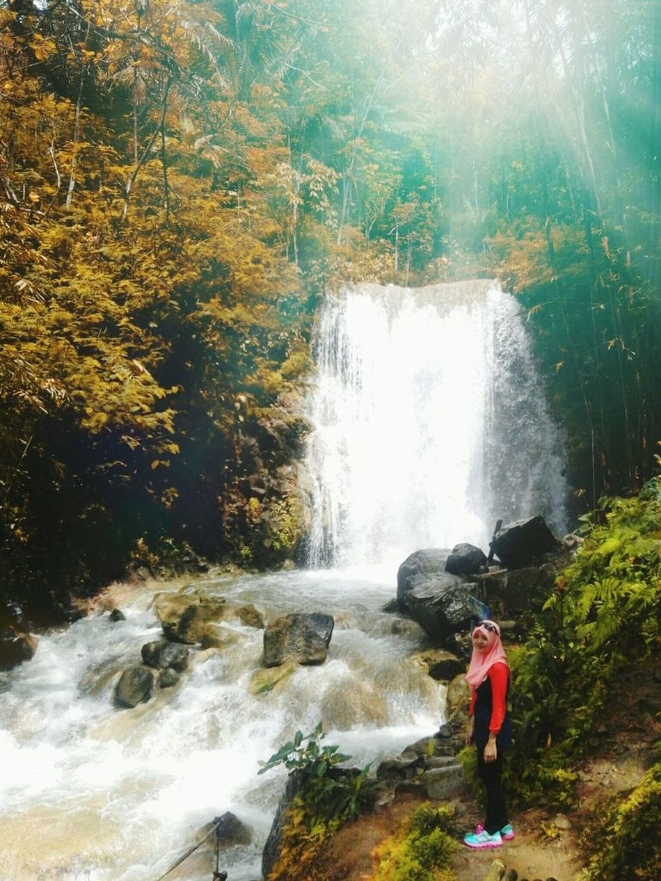 Muslim travellers Water Nature Beauty In Nature One Person Day Outdoors Waterfall waterfall #water #landscape nature beautiful Waterfalls💦 Indonesia_photography Photography Photographer Photo Of The Day Photo Love LoveNatureAndMountain Lovenaturalphotography Pictures