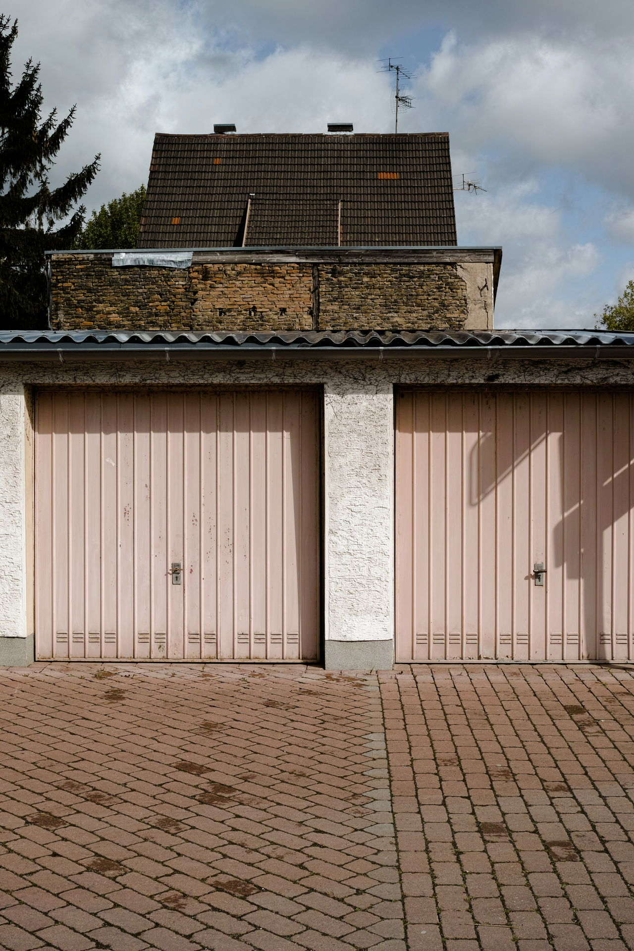 Garage Architecture Building Building Exterior Built Structure Cloud - Sky Cloudy Exterior Façade Garage Garage Doors Germany Old Wall Outdoors Overcast Pavement Roof Sky Suburbia Walkway Wall