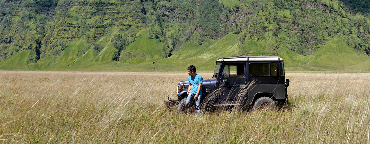 alone journey Alone Day Field Grass Journey Land Vehicle Leisure Activity Lifestyles Mammal Men Mode Of Transport Nature Only Men Outdoors People Real People Road Rural Scene Transportation Travel Tree Two People Women Young Adult