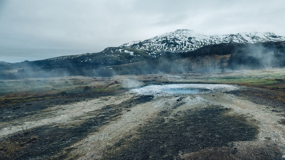 geisir, geyser, and highlands Beauty In Nature Cold Cold Temperature Geisir Highlands Iceland Landscape Mountain Nature No People Outdoors Scenic Scenics Snow Steam Tranquil Scene Tranquility Travel Destinations Winter Winter