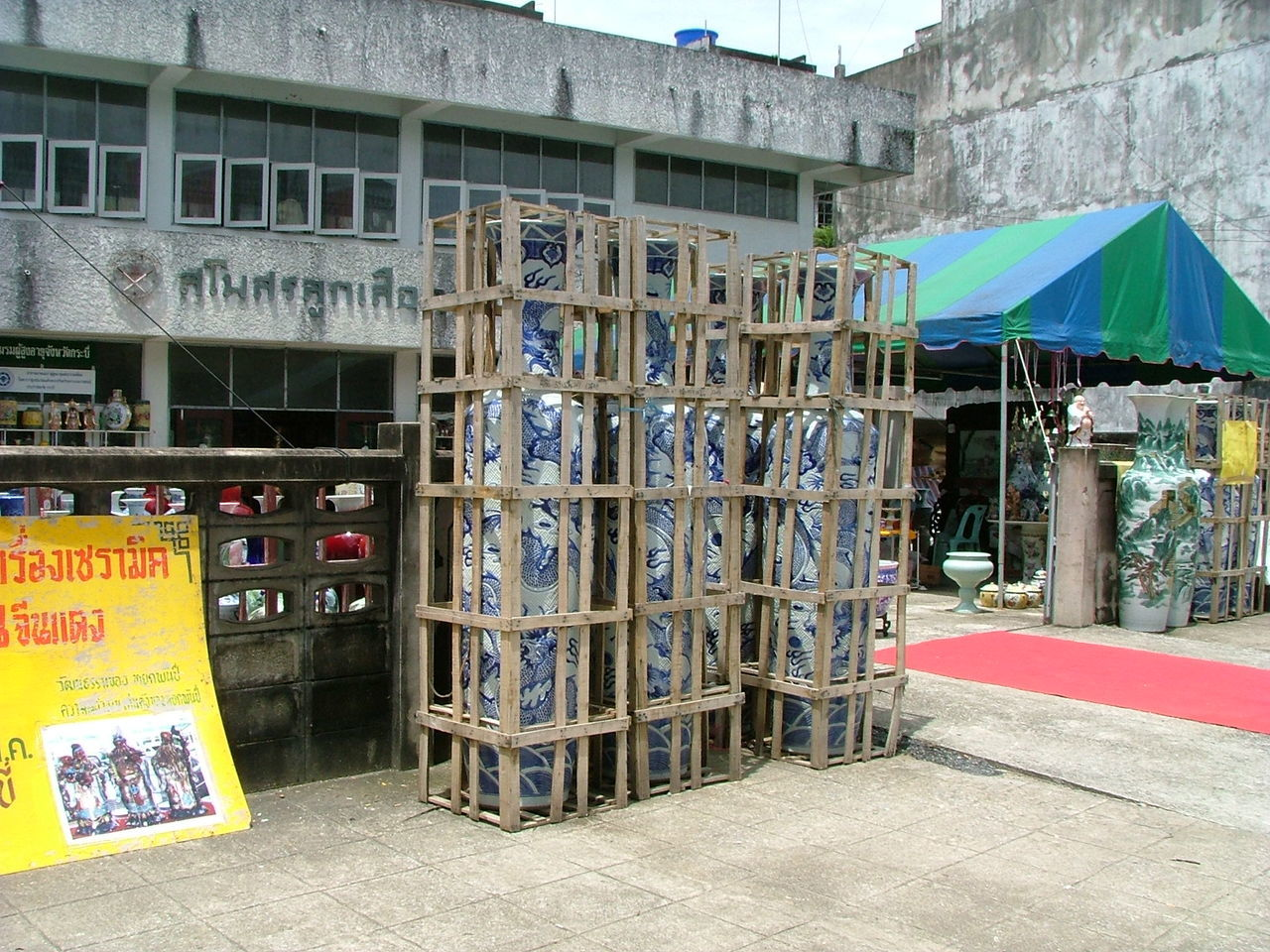 Architecture Asia. Building Exterior Communication Crates Market Multi Colored Outdoors Porcelain Vases In Crates. Porcelain Vases. Porcelain. Residential Building Shop Sidewalk Street Text Window Wooden Wooden Crates.