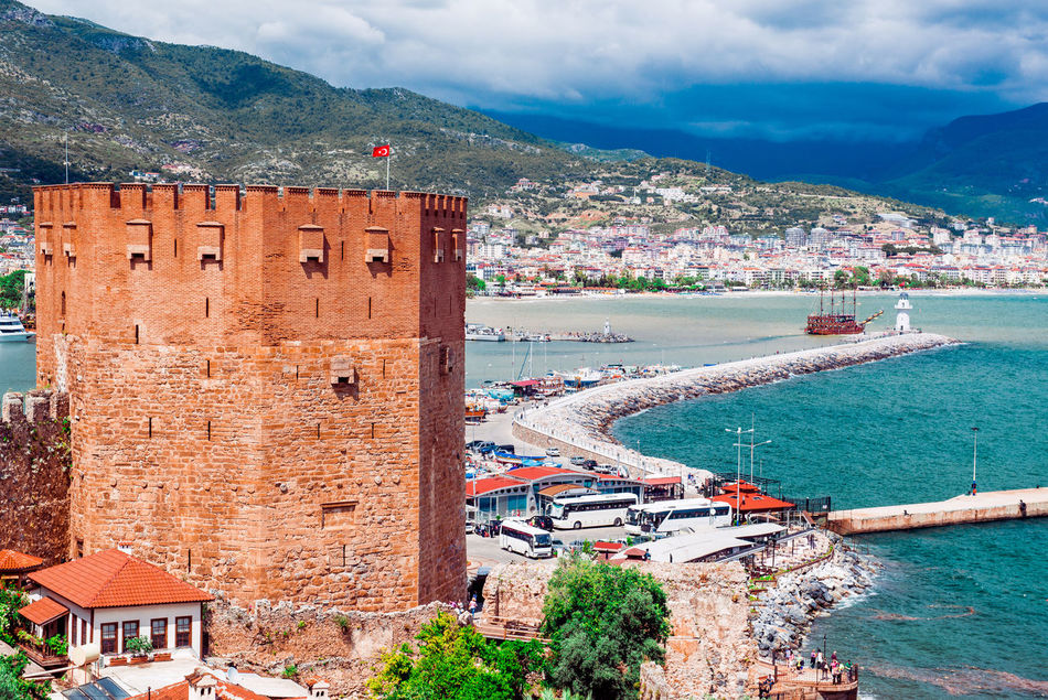 View of The Kizil Kule (Red Tower) is a historical tower in the Turkish city of Alanya Alanya Ancient Architecture Architecture ASIA Castle City Cloudy Sky Famous Place Fort Fortress Harbor Kızıl Kule Landscape Mediterranean Sea Middle East Mountains Outdoors Red Tower Scenery Sea Tower Turkey Turkish Turkish Riviera Wall