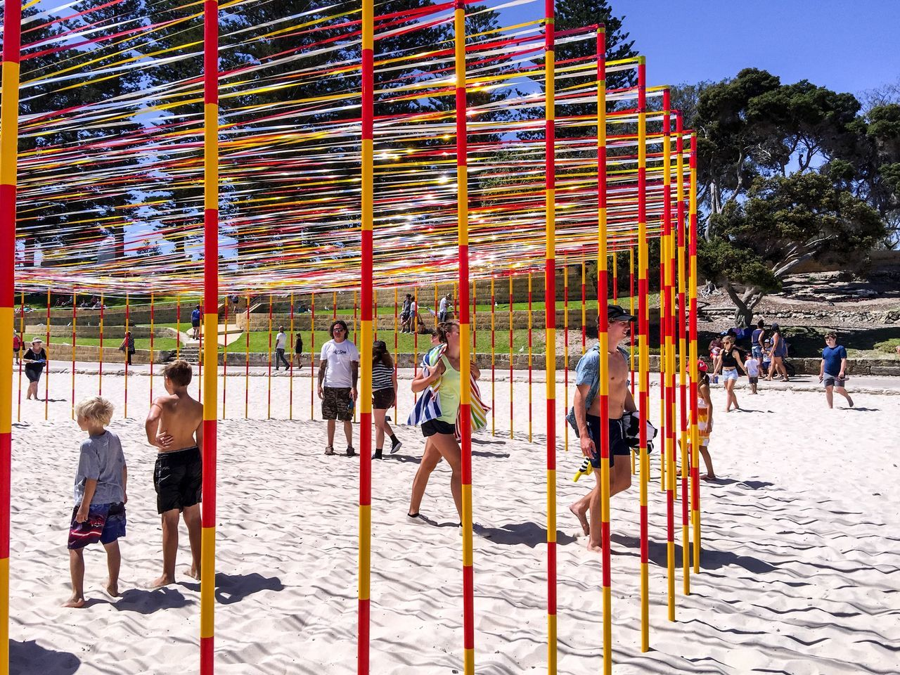 Interactive Arts Festival: Sculptures by the Sea 2016 Poles Ribbons Colorful Red Yellow Striped Pattern Arts Festivals Tourist Attraction  Sculpture Western Australia Cottesloe Beach ArtWork Sculptures By The Sea Interactive  March 12,2016 Arts Culture And Entertainment Sand Tourists Beach Abstract Families Pattern Circular Fun Modern Art