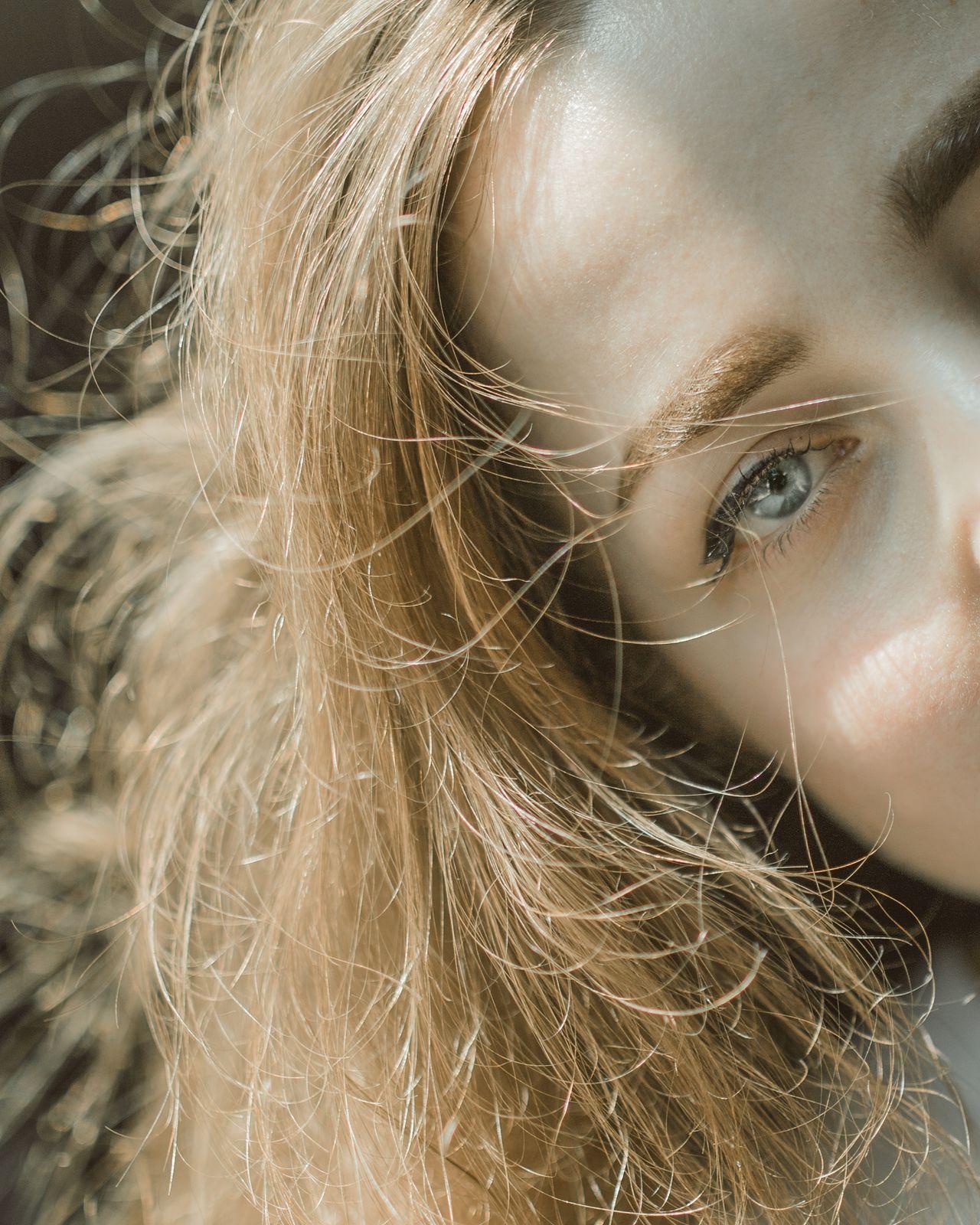 Stone cold Close-up Uniqueness Outdoors Faces Of EyeEm Women Of EyeEm Natural Light Portrait Beautiful People Portrait Of A Girl Portrait Of A Woman Portrait Photography Eye Blue Eyes Grey Eyes Fashion Portrait Blond Golden Hair  Hair