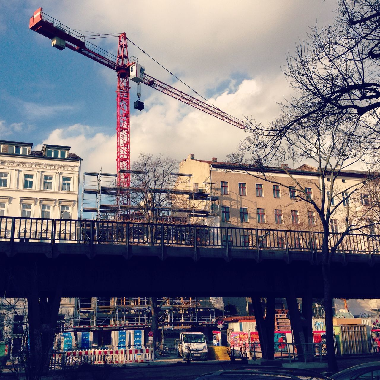 Architecture Baugruppe Building Exterior Built Structure City Cloud - Sky Construction Construction Site Crane Crane - Construction Machinery Cranes Day Development Empty Gap Site Infill Infill Housing Kreuzberg No People Outdoors Red Crane Skalitzer Straße Sky Transportation Water