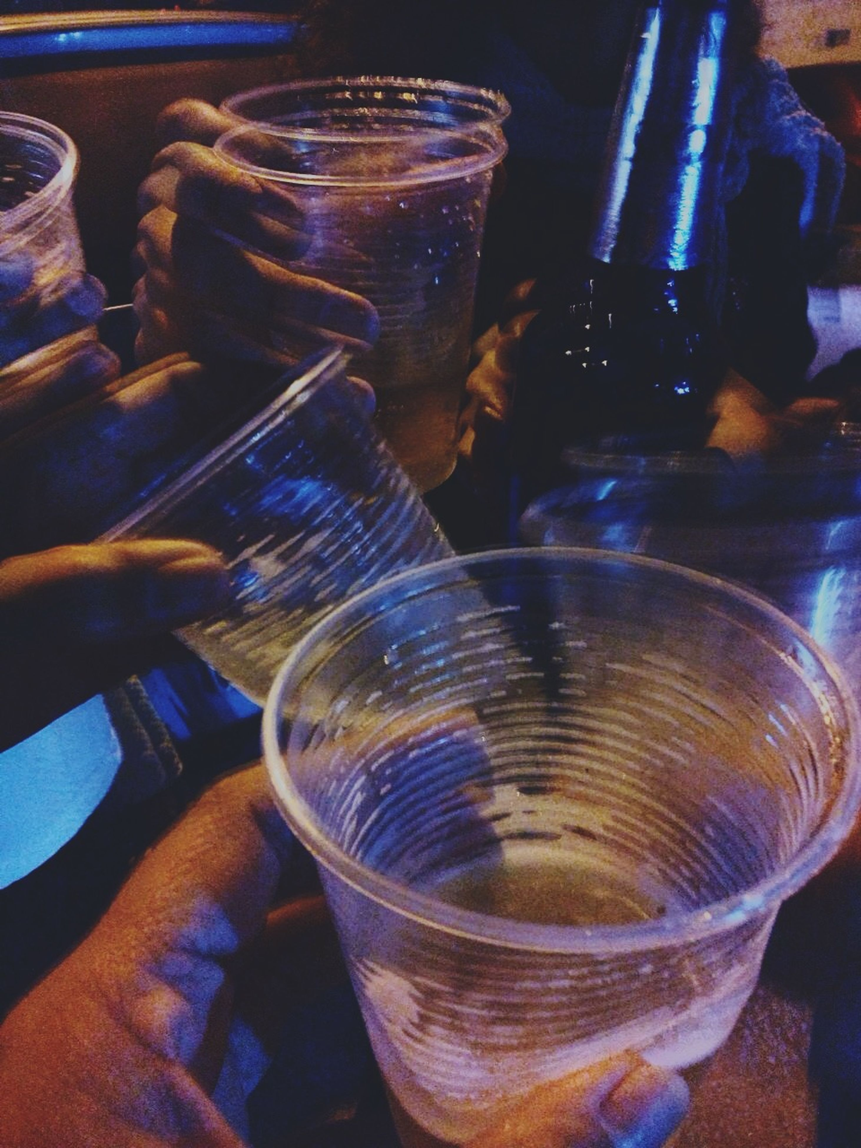 drink, indoors, refreshment, food and drink, drinking glass, glass - material, close-up, freshness, table, transparent, glass, still life, alcohol, high angle view, bottle, person, part of, unrecognizable person
