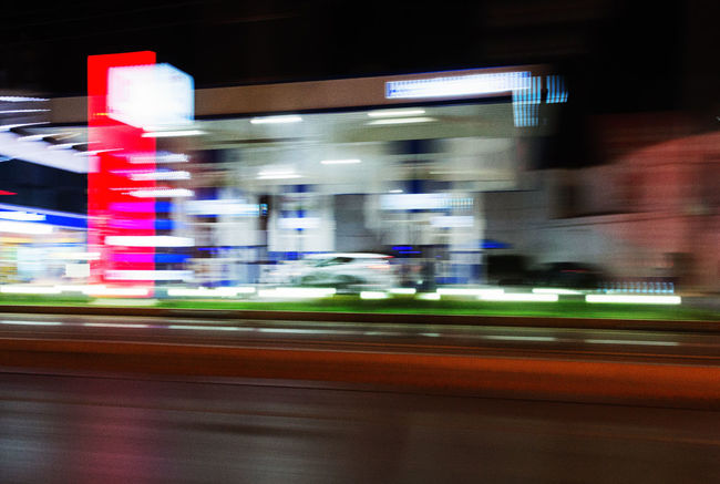 On The Move Architecture Blurred Motion Building Exterior Capturing Motion City City Life Gas Gas Station Gasoline Pump Horizontal Illuminated Light Trail Long Exposure Motion Night No People Outdoors Public Transportation Speed Transportation