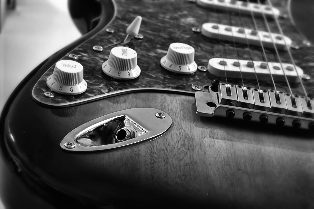 music, musical instrument, musical instrument string, arts culture and entertainment, high angle view, no people, fretboard, guitar, indoors, close-up, technology, day