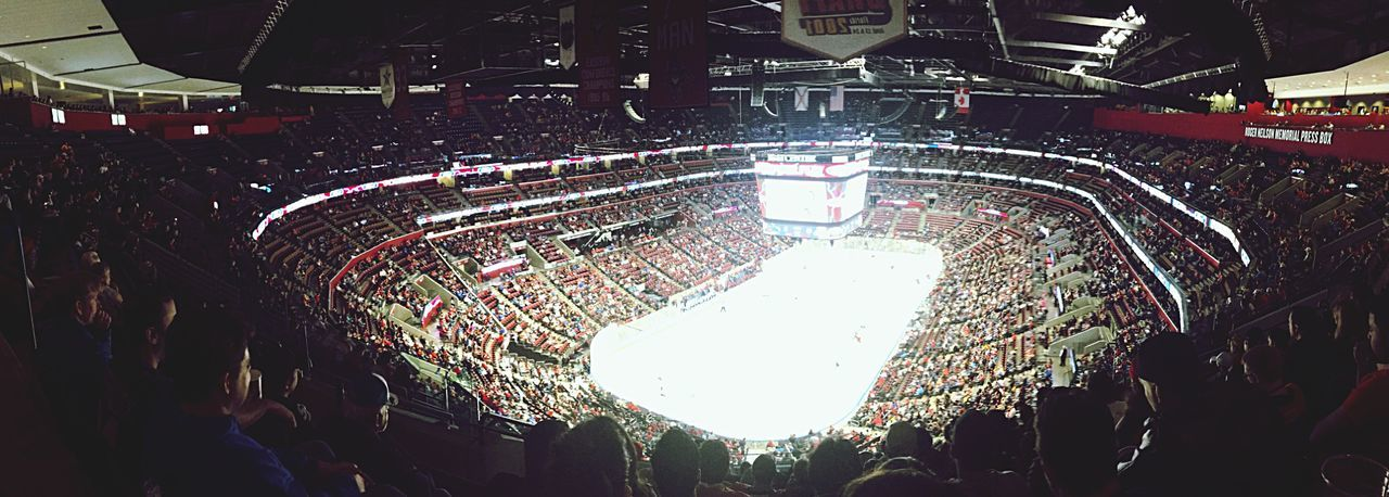 large group of people, crowd, illuminated, stadium, night, mixed age range, audience, real people, men, high angle view, spectator, leisure activity, sport, ice rink, fan - enthusiast, indoors, people, adult