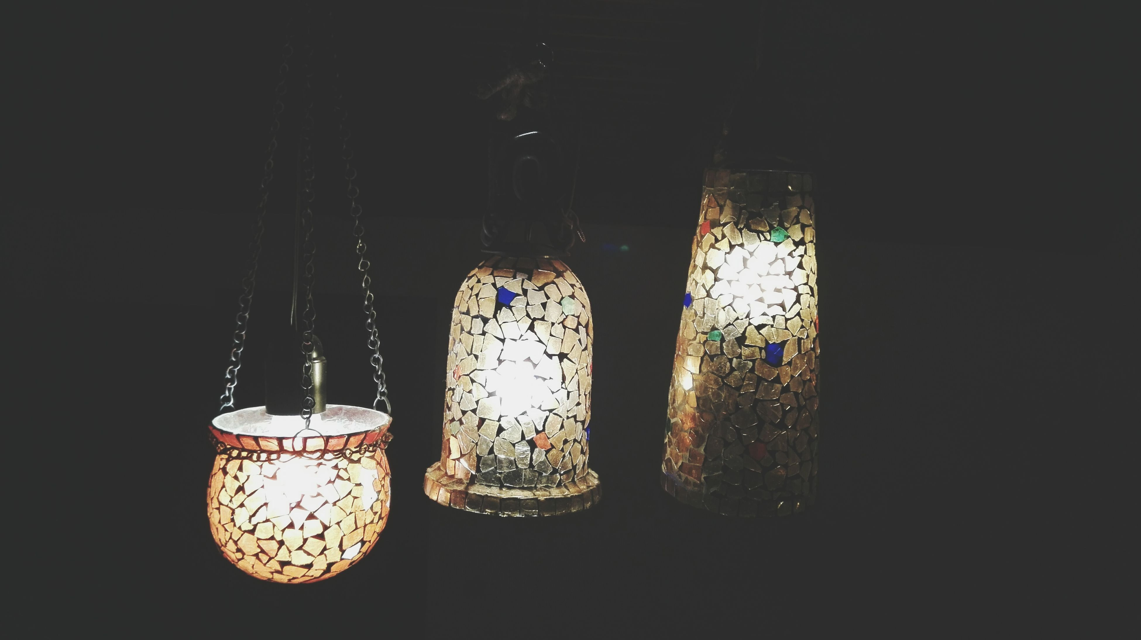 illuminated, lighting equipment, indoors, hanging, night, glass - material, reflection, window, close-up, transparent, electricity, dark, decoration, no people, light bulb, electric light, metal, light - natural phenomenon, glowing, lantern