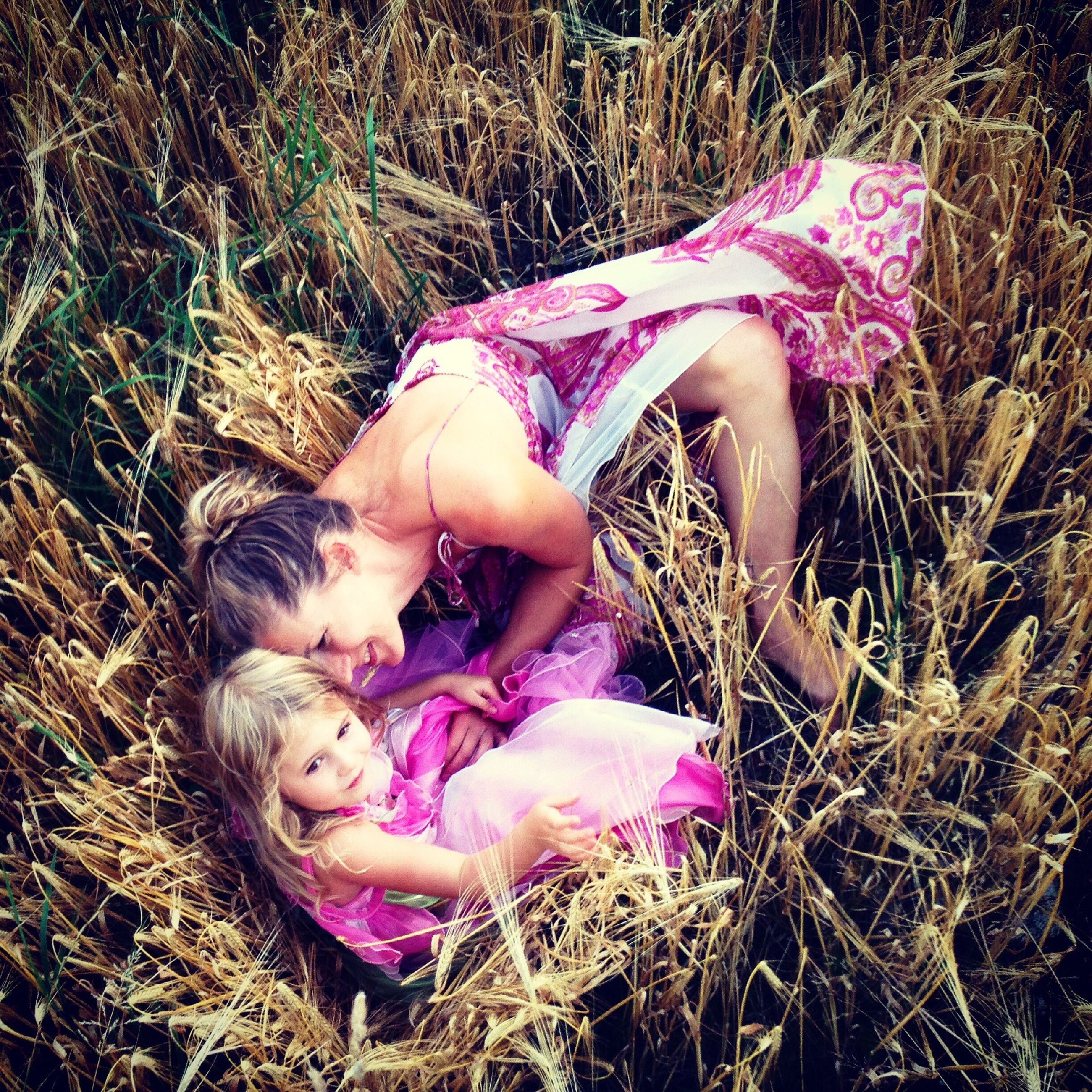 childhood, field, grass, high angle view, elementary age, person, lying down, lifestyles, full length, leisure activity, innocence, relaxation, girls, cute, day, grassy, sitting, playful