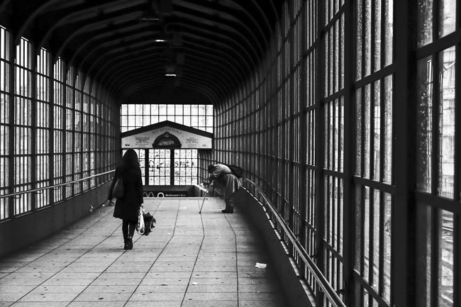 the difference ... Alley Architecture Bahnhof Beggar Berlin Bettler Blackandwhite Citylife Corridor Dame Fence The Street Photographer - 2015 EyeEm Awards Indoors  Lady Lazar Narrow Real People SA Sharing  Stadtleben Streetphotography My Best Photo 2015 Traurig Urbanphotography Windows