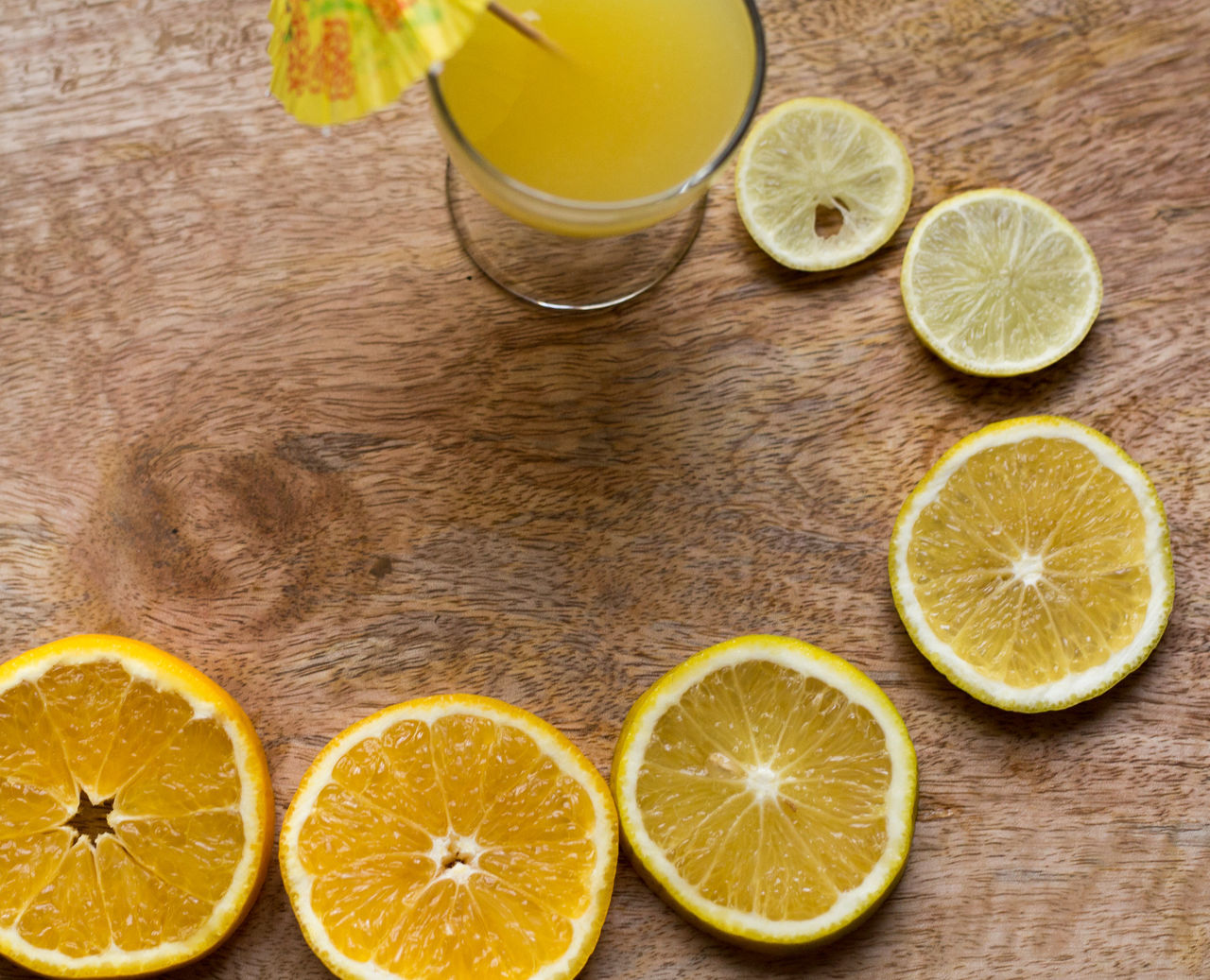 Citrus Fruit Close-up Cross Section Directly Above Drink Drinking Glass Food And Drink Freshness Fruit Grapefruit Halved Healthy Eating Indoors  Kiwi - Fruit Lemon Lime No People Orange Juice  SLICE Sour Taste Squeezing Table Vitamin Wood - Material Yellow