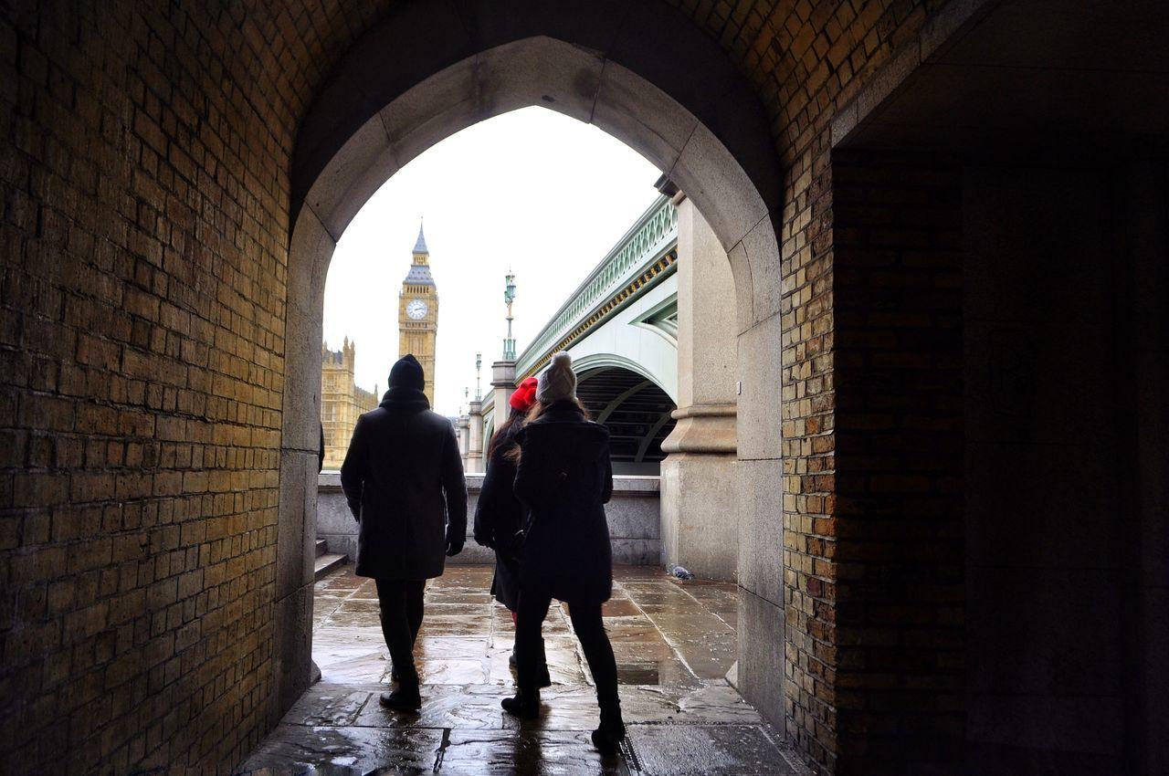 Big Ben Arch Architecture Men City Lifestyles Travel Destinations Friendship Full Length People Tunnel Warm Clothing Winter London London Lifestyle Europe Travel Trip Westminster Bridge