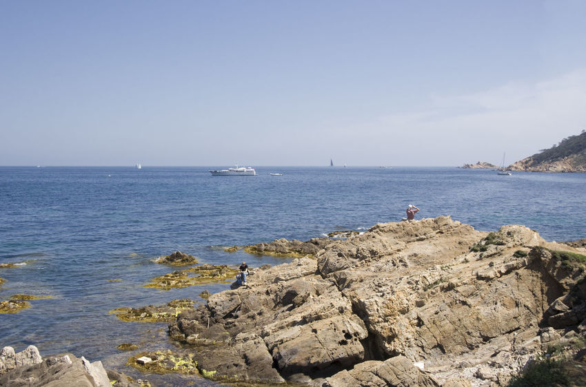 cliffs on the french riviera - with people looking over water Beach Beauty In Nature Clear Sky Cliff Coastline Côte D'Azur France French Riviera Gulf Of Saint-tropez Horizon Over Water Landscape Landscape_Collection Leisure Activity Lifestyles Mediterranean Sea Nautical Vessel People Real People Relaxation Rocky Coastline Saint-Tropez Scenics Sea Seascape Vacations