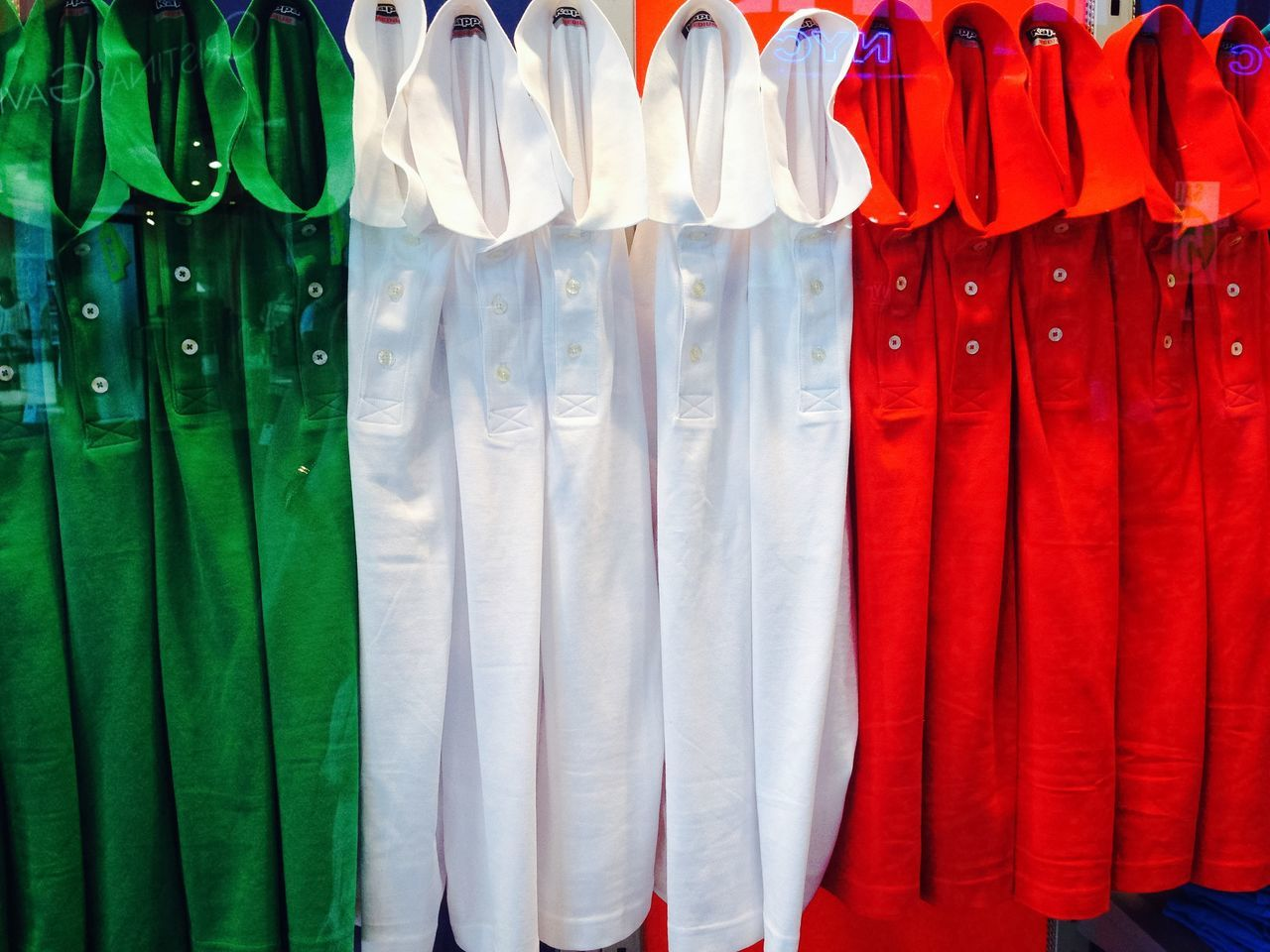 in a row, hanging, no people, multi colored, clothing, textile, variation, indoors, day, coathanger, close-up