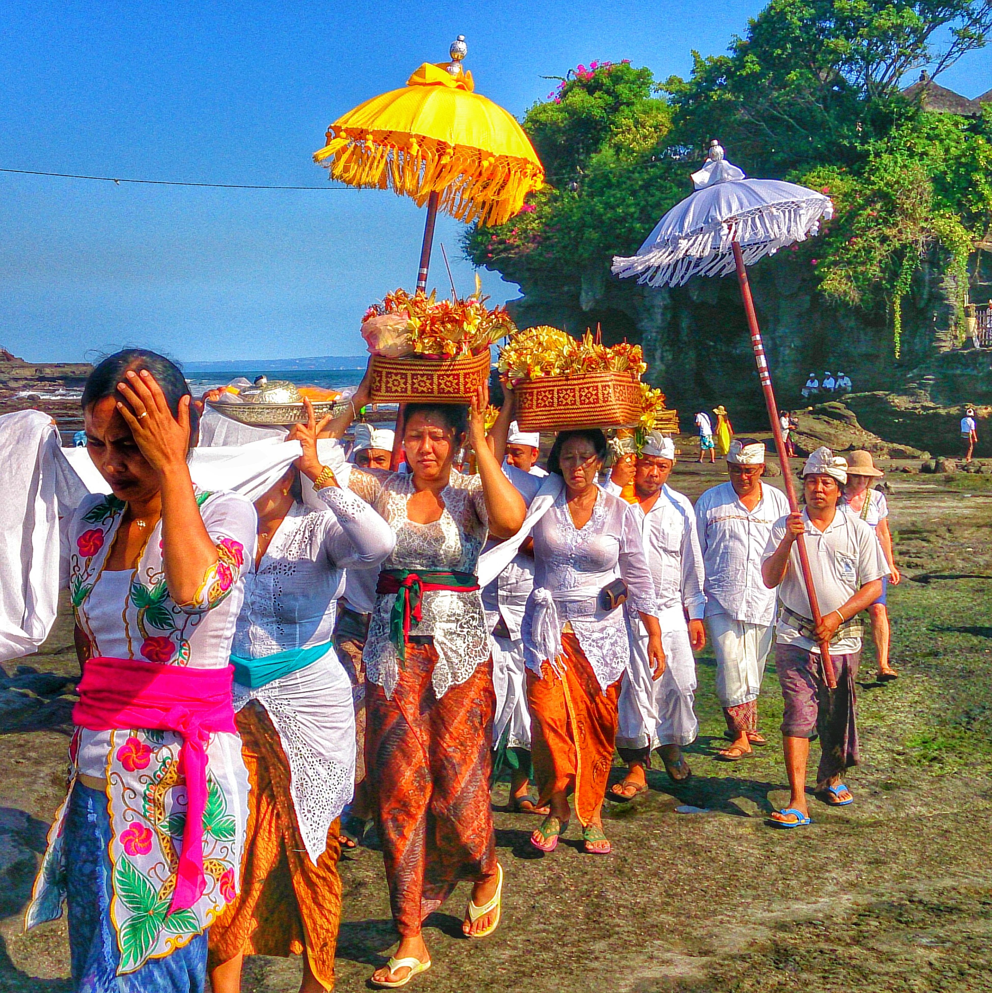 leisure activity, lifestyles, men, clear sky, tradition, sky, celebration, tree, casual clothing, cultures, person, standing, fun, blue, enjoyment, traditional clothing, arts culture and entertainment, day