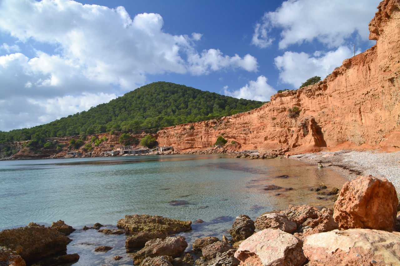 Landscape of Sa Caleta beach in Ibiza, Spain Balearic Balearic Islands Beach Cala Cloud Coastline Ibiza Idyllic Illes Balears Island Islas Baleares Landscape Mountain Nature Outdoors Picturesque Rock Sa Caleta Scenics SPAIN Tourism Touristic Tranquil Scene Travel Water