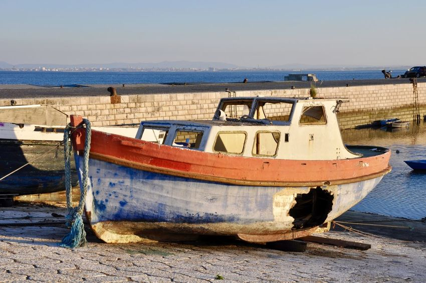 Painted Wreck Boat Colorful Longtail Boat Mode Of Transport Moored Nature Nautical Vessel No People Outdoors Sea Sunset Transportation Water Wrecked Wrecked Boat.