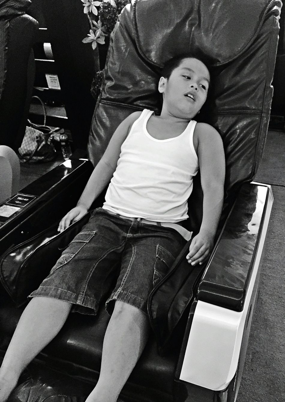 My beloved nephew enjoying the massage chair. Capture The Moment Massage Therapy Massages Massage Time Massage Chairs Faces In Places Relaxation Expression Boy Young Boy Getty X EyeEm Telling Stories Differently Human Meets Technology