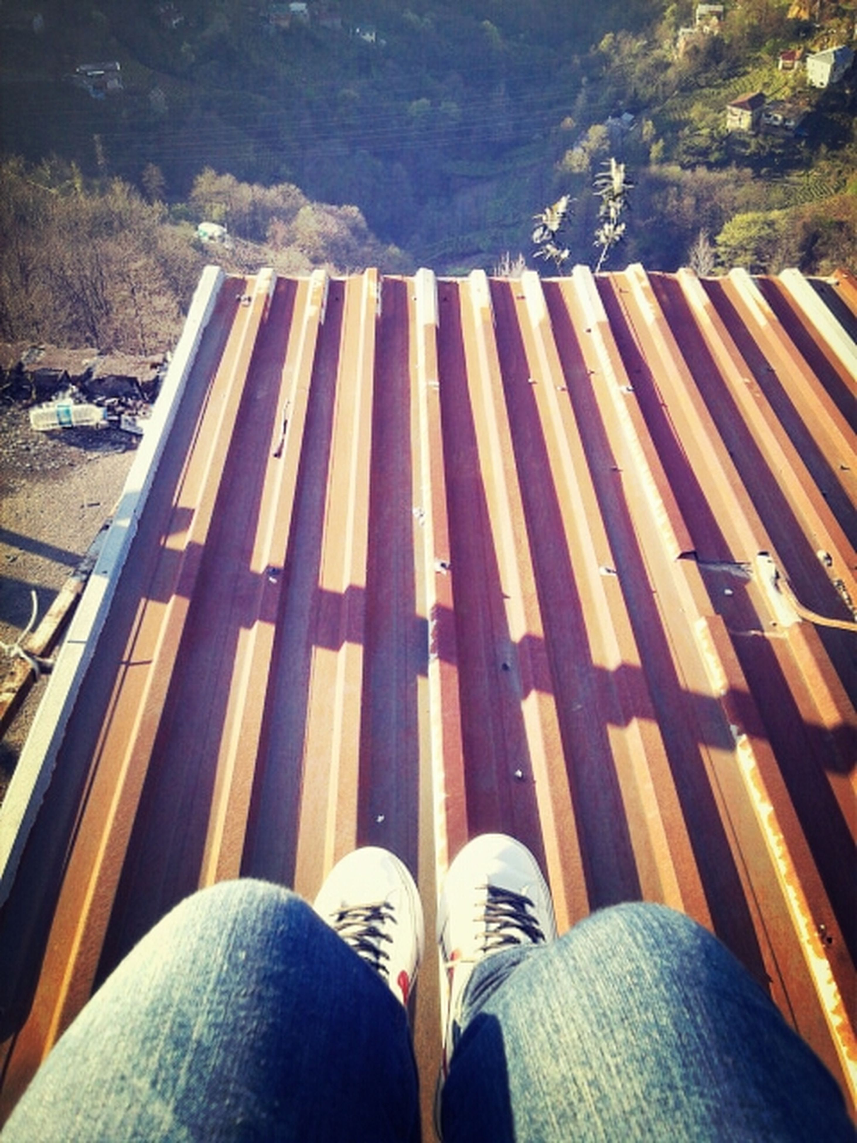 low section, person, shoe, personal perspective, human foot, footwear, lifestyles, high angle view, standing, men, unrecognizable person, leisure activity, jeans, relaxation, outdoors, day, nature