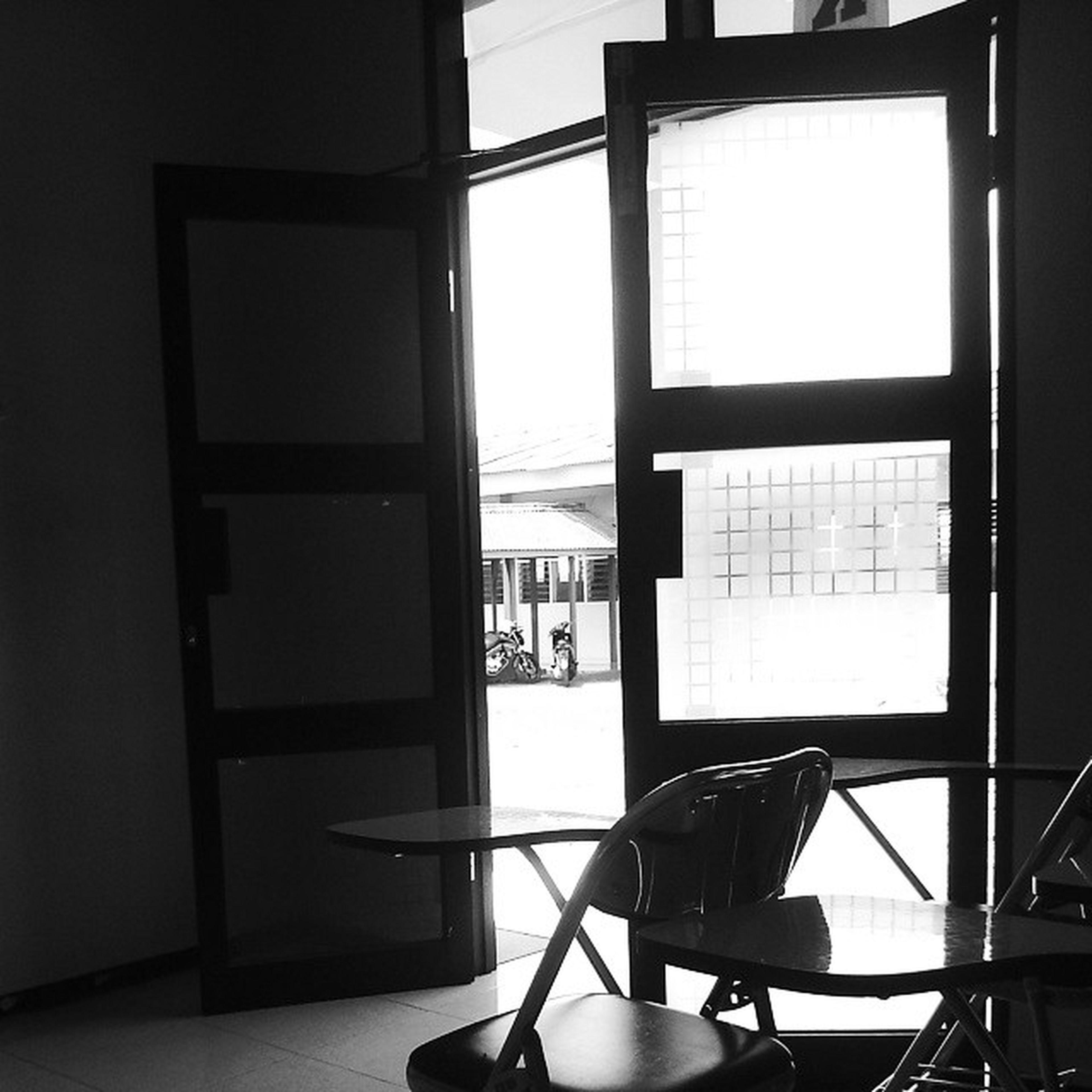 indoors, window, architecture, built structure, glass - material, transparent, home interior, day, chair, interior, no people, absence, building, wall, sunlight, table, modern, railing, building exterior, empty