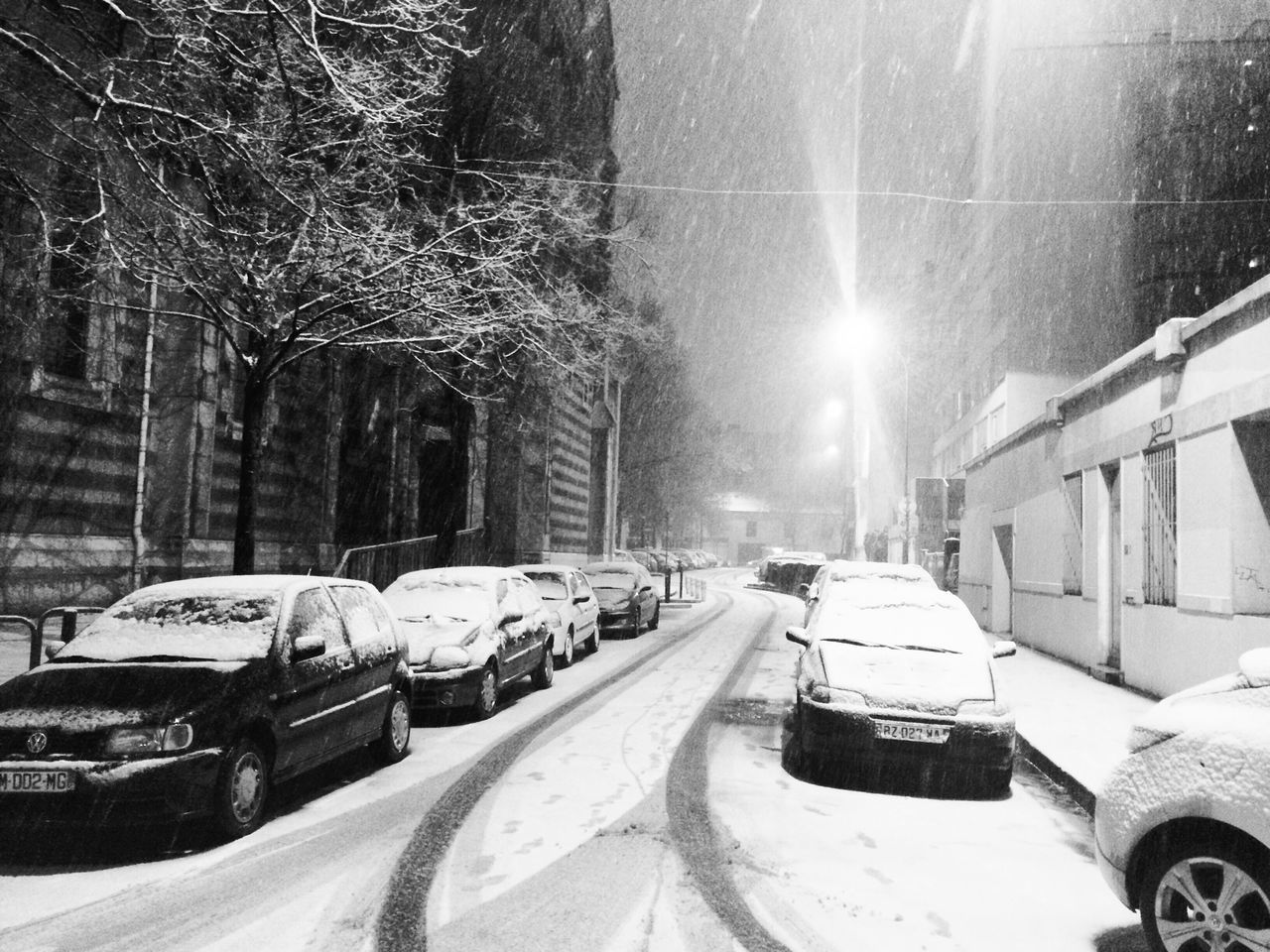 car, land vehicle, transportation, mode of transport, snow, winter, cold temperature, street, stationary, building exterior, architecture, outdoors, built structure, tree, road, no people, day, nature, city