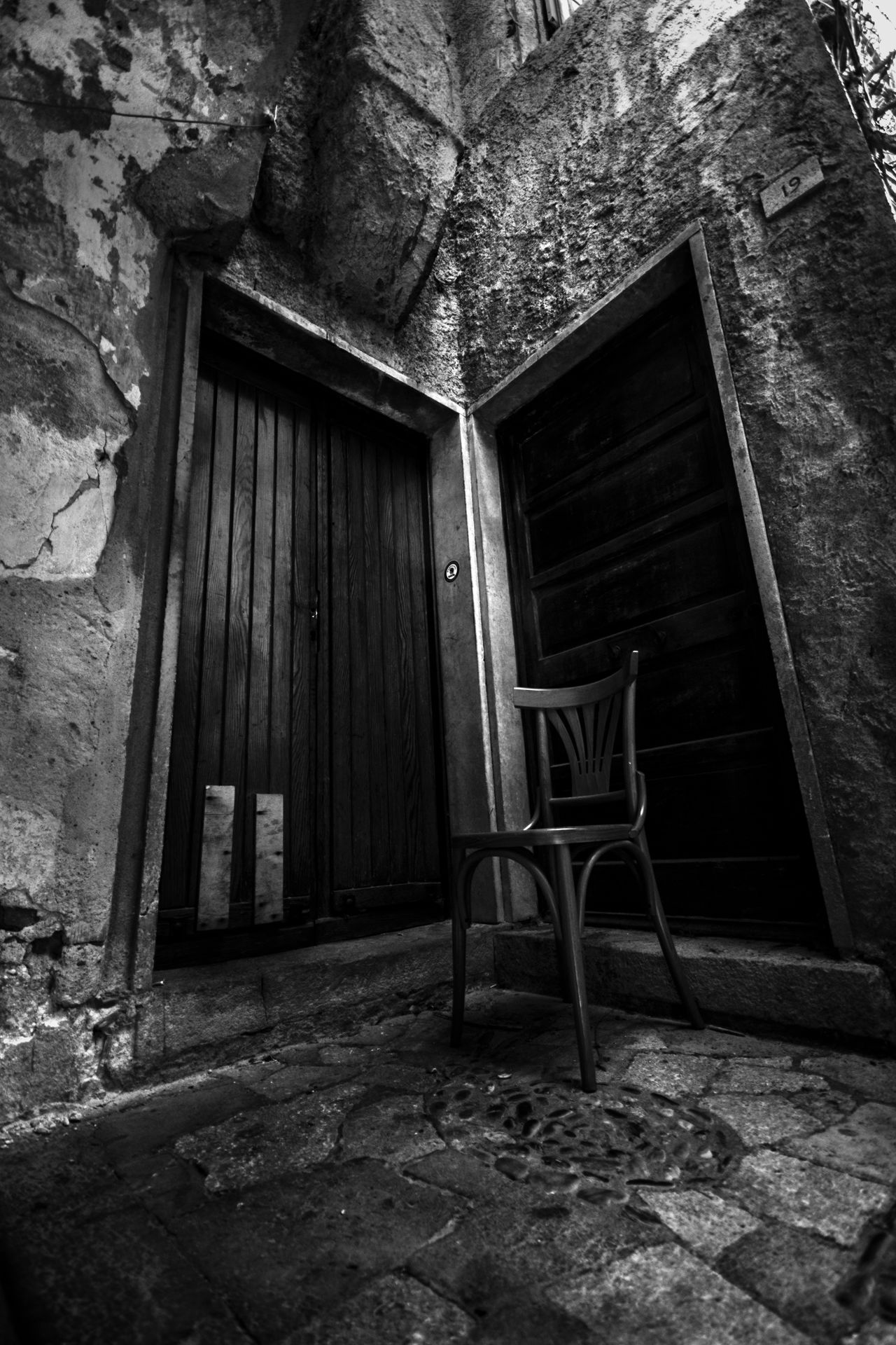 Alley Ancient Architecture Black & White Black And White Buildings Built Structure Chair Day Door Doors EyeEm Gallery History No People Old Old Buildings