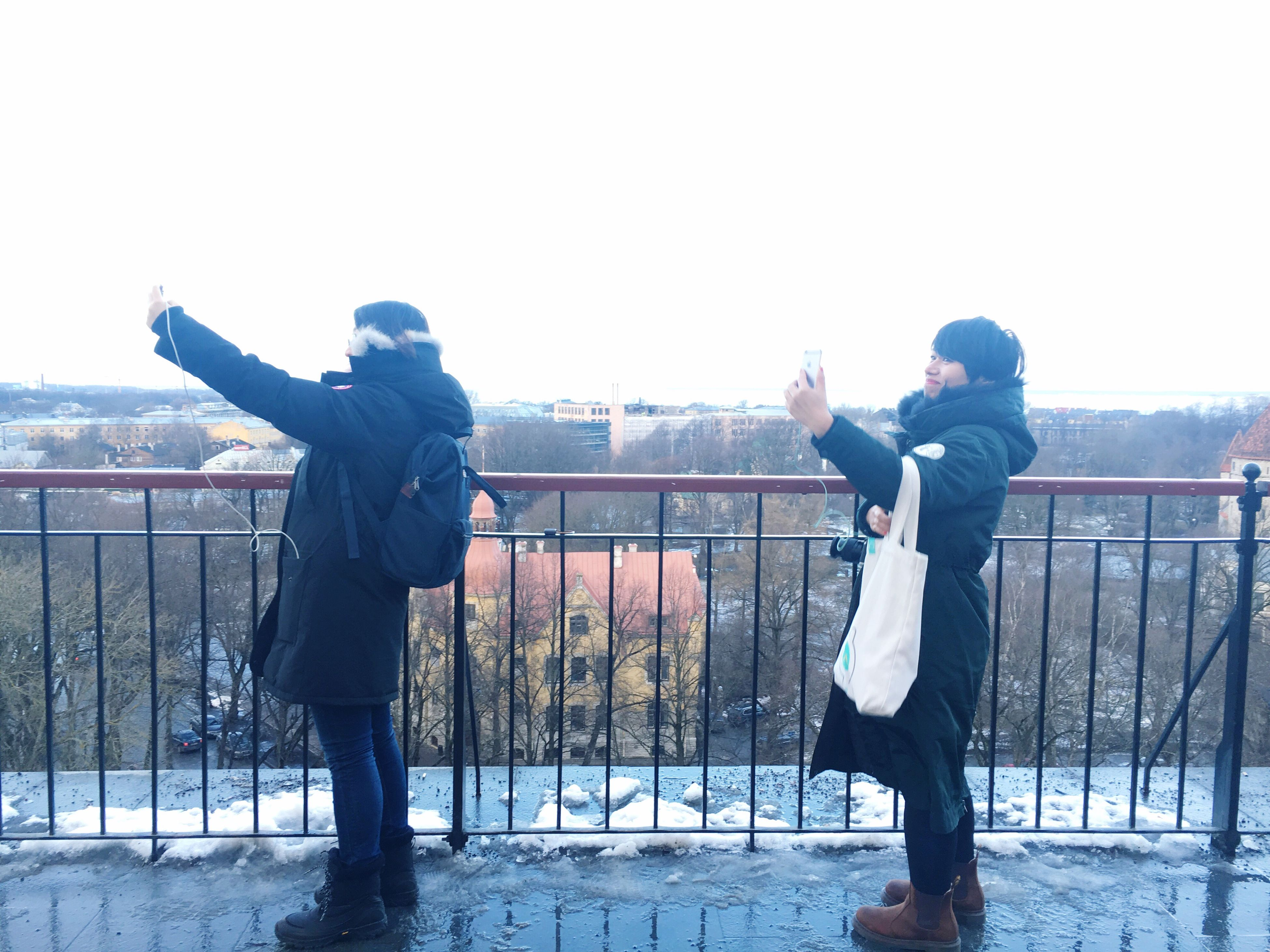 railing, winter, warm clothing, young adult, friendship, outdoors, adults only, people, cold temperature, playing, adult, full length, bridge - man made structure, togetherness, real people, only men, sport, men, snow, day, human body part, sky, sportsman, human hand